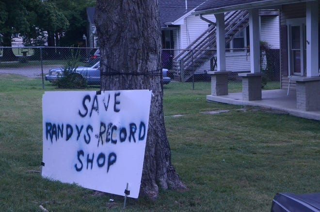 """Johnny Griffin displays a sign at his business on North Water Avenue in Gallatin to """"Save Randy's Record Shop."""""""