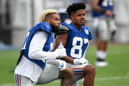 New York Giants wide receivers Odell Beckham Jr., left, and Sterling Shepard, right, watch drills during NFL training camp in East Rutherford, NJ on Wednesday, August 1, 2018.