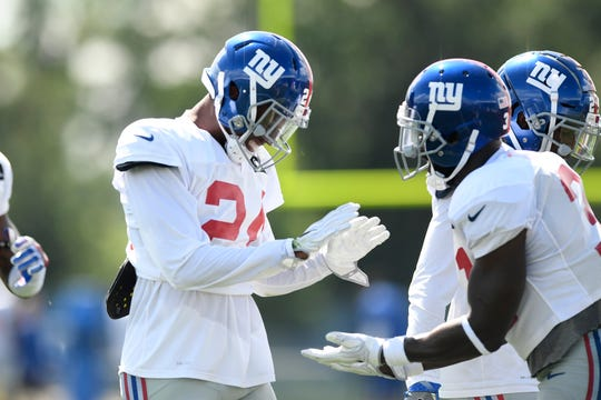 New York Giants cornerback Eli Apple (24) celebrates breaking up a pass intended for Odell Beckham Jr. (not pictured) during NFL training camp in East Rutherford, NJ on Wednesday, August 1, 2018.