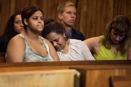 (center) The mother of Dervy Almonte-Moore during a court appearance of Joel Nunez, 18, and Andy DeJesus, 18, in Superior Court on Tuesday, August 1, 2018. Nunez and DeJesus are accused of killing her son, a pizza delivery driver in Clifton on Tuesday, August 1, 2018.