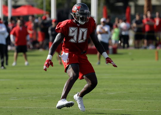 In this July 28, 2018 file photo,Tampa Bay Buccaneers defensive end Jason Pierre-Paul (90) runs a drill during an NFL football training camp practice in Tampa, Fla.