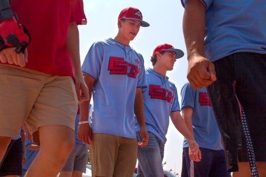 Members of the 4C Club Sox arrive at the Pinon Hills Community Church in Farmington Wednesday for Connie Mack World Series registration.