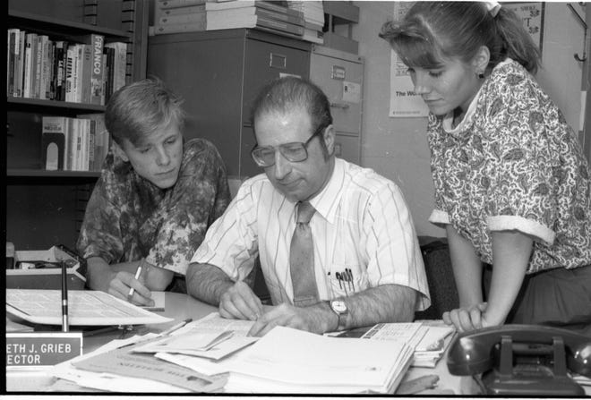 Kenneth Grieb works with students. Grieb died July 13.