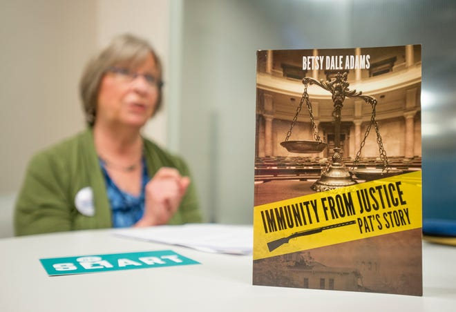 "Betsy Dale Adams, of Gulf Breeze, talks about her book ""Immunity from Justice: Pat's Story"" on Wednesday."