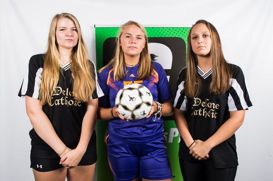 (From left) Delone Catholic soccer players Rachel Swingler, Lindsey Vandergrift and Bella Nace pose in the GameTimePA photo booth during fall sports media day in Hanover on Wednesday, August 1, 2018.
