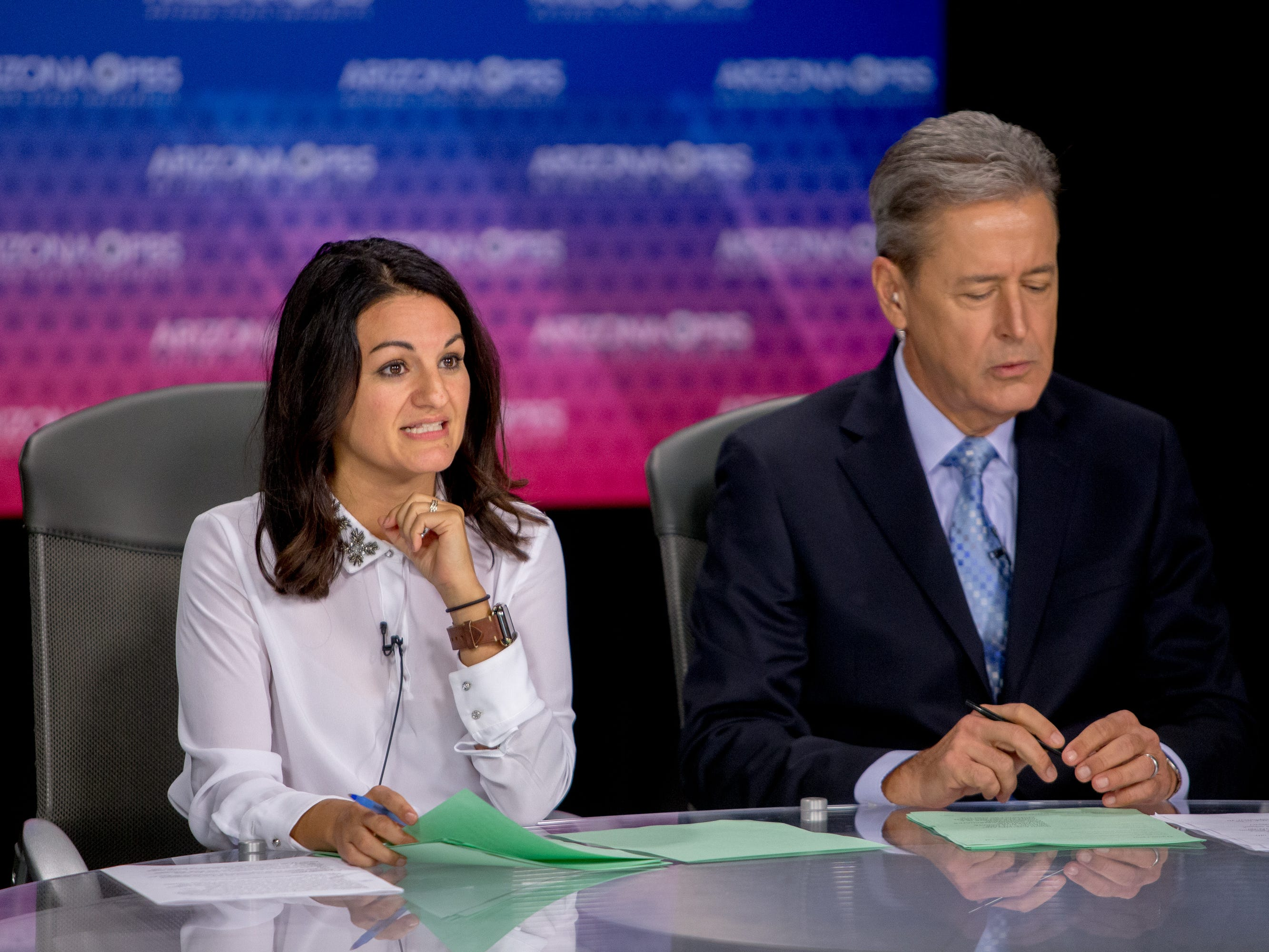 Moderators Yvonne Wingett Sanchez and Ted Simons go through the program opening on July 31, 2018, during a debate among Democrats vying for Arizona governor at Arizona State University's Walter Cronkite School of Journalism in Phoenix, Arizona.