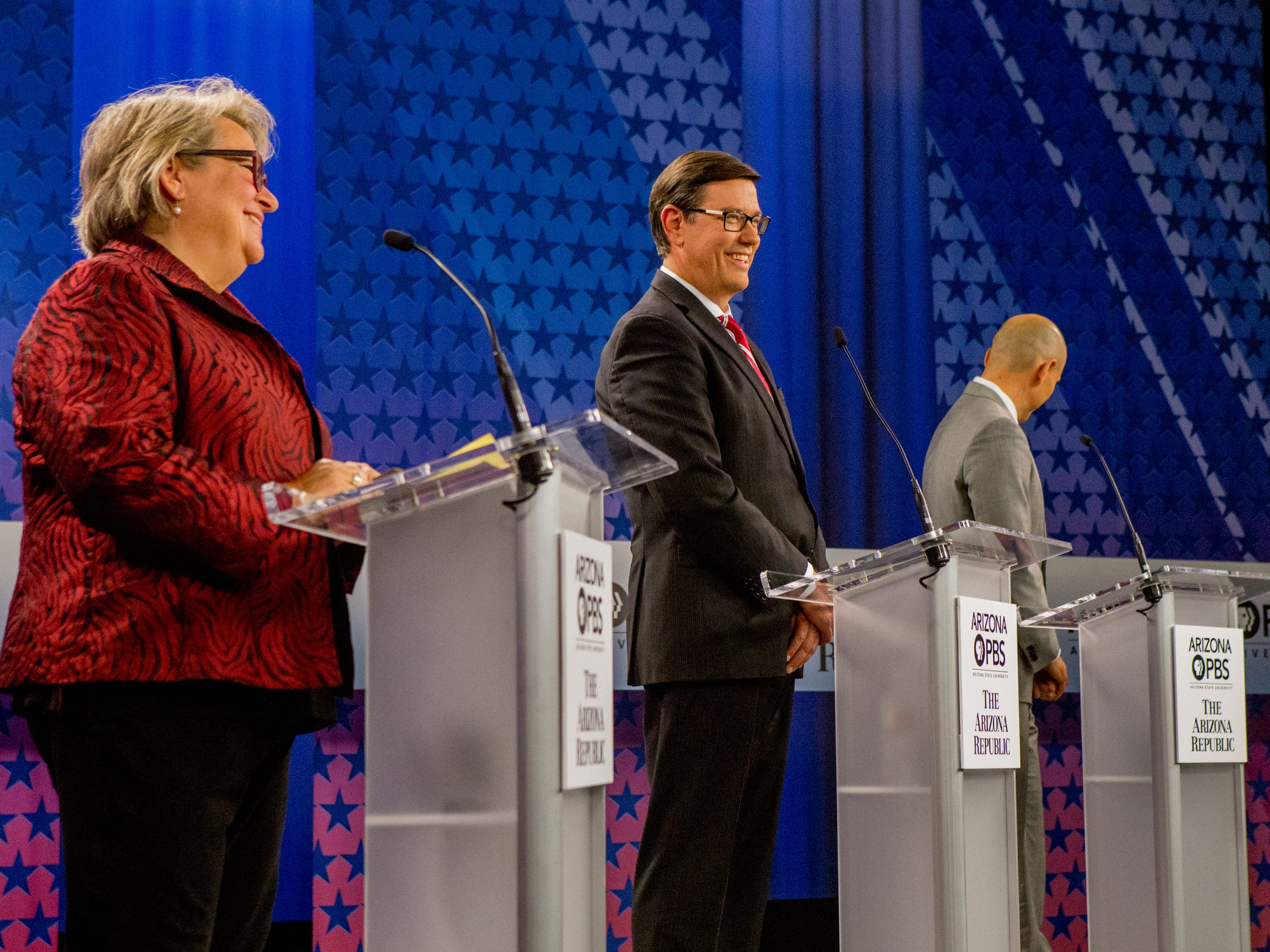 Democratic gubernatorial candidates wait for the beginning of the program on July 31, 2018, during a debate among Democrats vying for Arizona governor at Arizona State University's Walter Cronkite School of Journalism in Phoenix, Arizona.