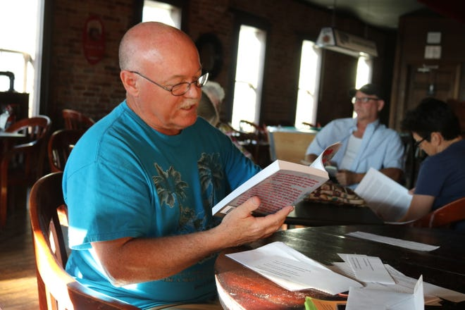 """P.J. Grondin, a fiction author from Sandusky, reads an excerpt from his latest novel, """"Under the Blood Tree,"""" during the GPCAAC's Writers Circle in July."""