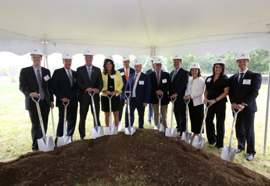 Dignitaries pose for a photo during the ground breaking ceremony for Eastdale Village in the Town of Poughkeepsie on August 1, 2018.
