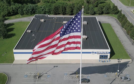 Visitors in the area of the West Manchester Town Center may notice giant splash of patriotic color in the sky. Gander Outdoors, an outdoor sports retailer, has installed a 130 foot flag pole on which a 40x80 foot American flag is flying. Gander Outdoors will have an official flag raising ceremony, Friday, August 11 at 9 .m. which will feature local military and law enforcement personnel to help raise colors. Sunday, July 29, 2018. John A. Pavoncello photo