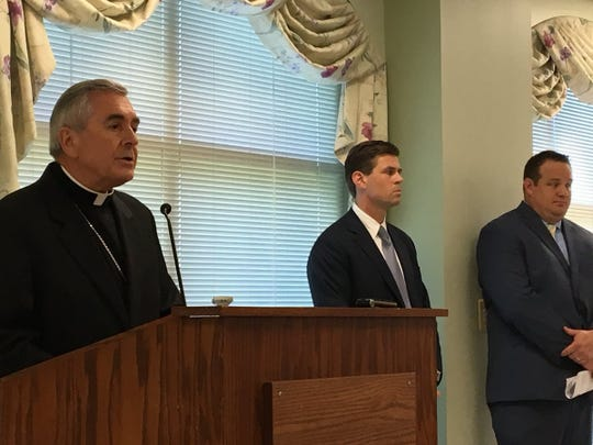 Harrisburg diocese Bishop Ronald Gainer, left, on Aug. 1 discusses the release of a list of clergy accused of sexual abuse. Diocese attorney Matt Haverstick is in the middle, and diocese spokesman Mike Barley is on the right.