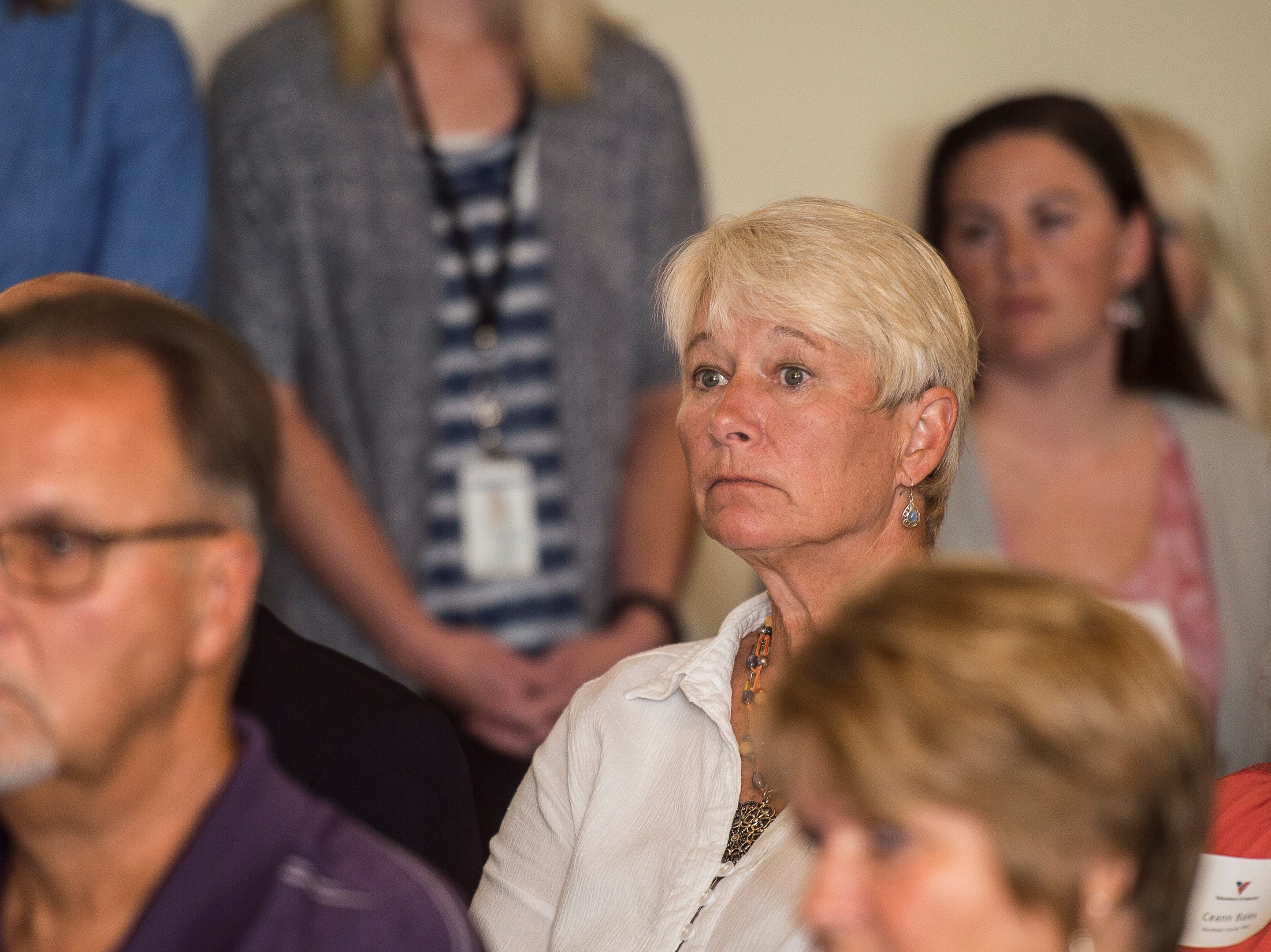 Winchester City Council member Missy Williams listens during a news conference celebrating the opening of the Winchester House, a new drug treatment facility for women, in Winchester, Ind., on Wednesday, Aug. 1, 2018.