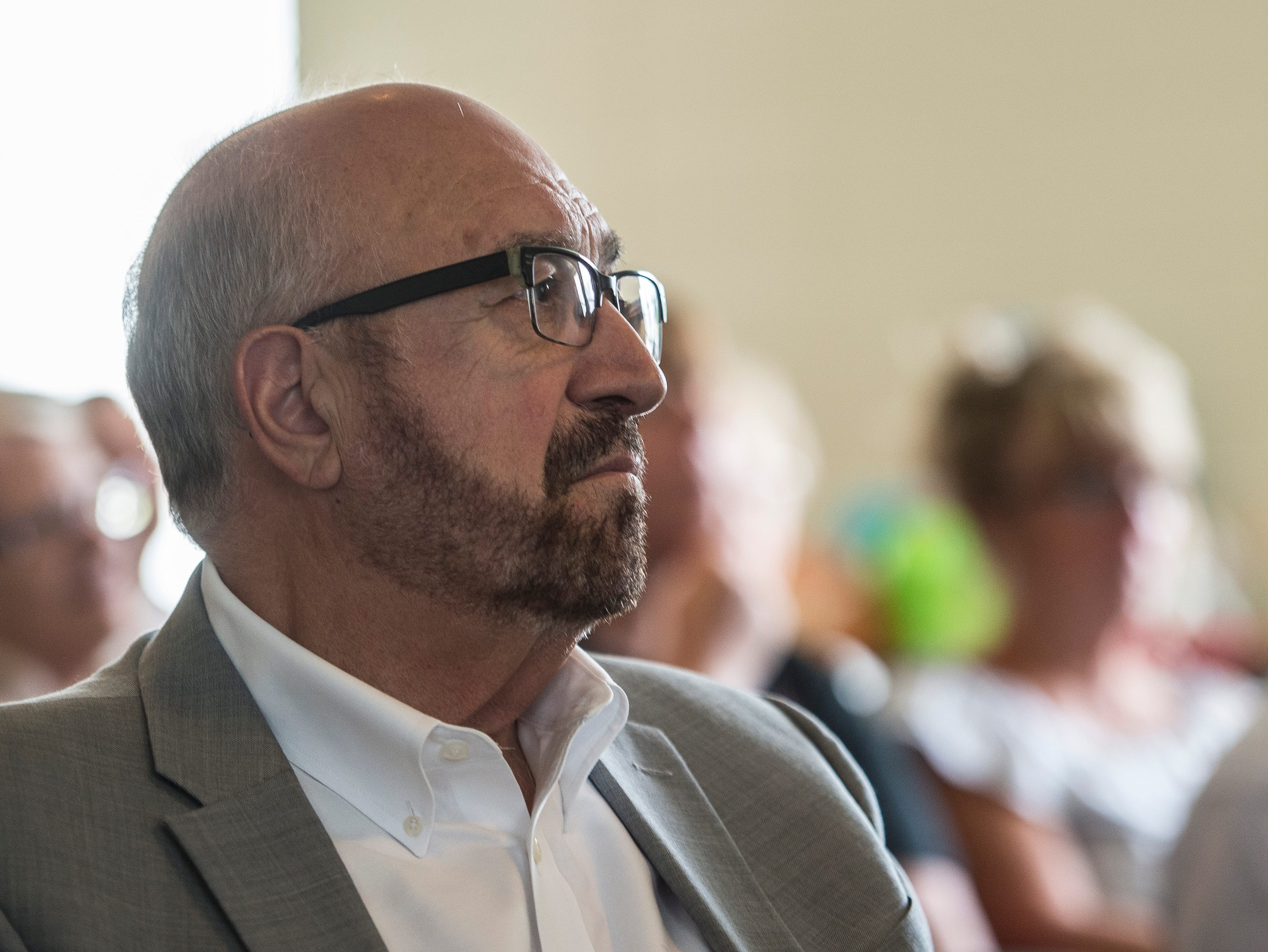 A man listens during a news conference celebrating the opening of the Winchester House, a new drug treatment facility for women, in Winchester, Ind., on Wednesday, Aug. 1, 2018.