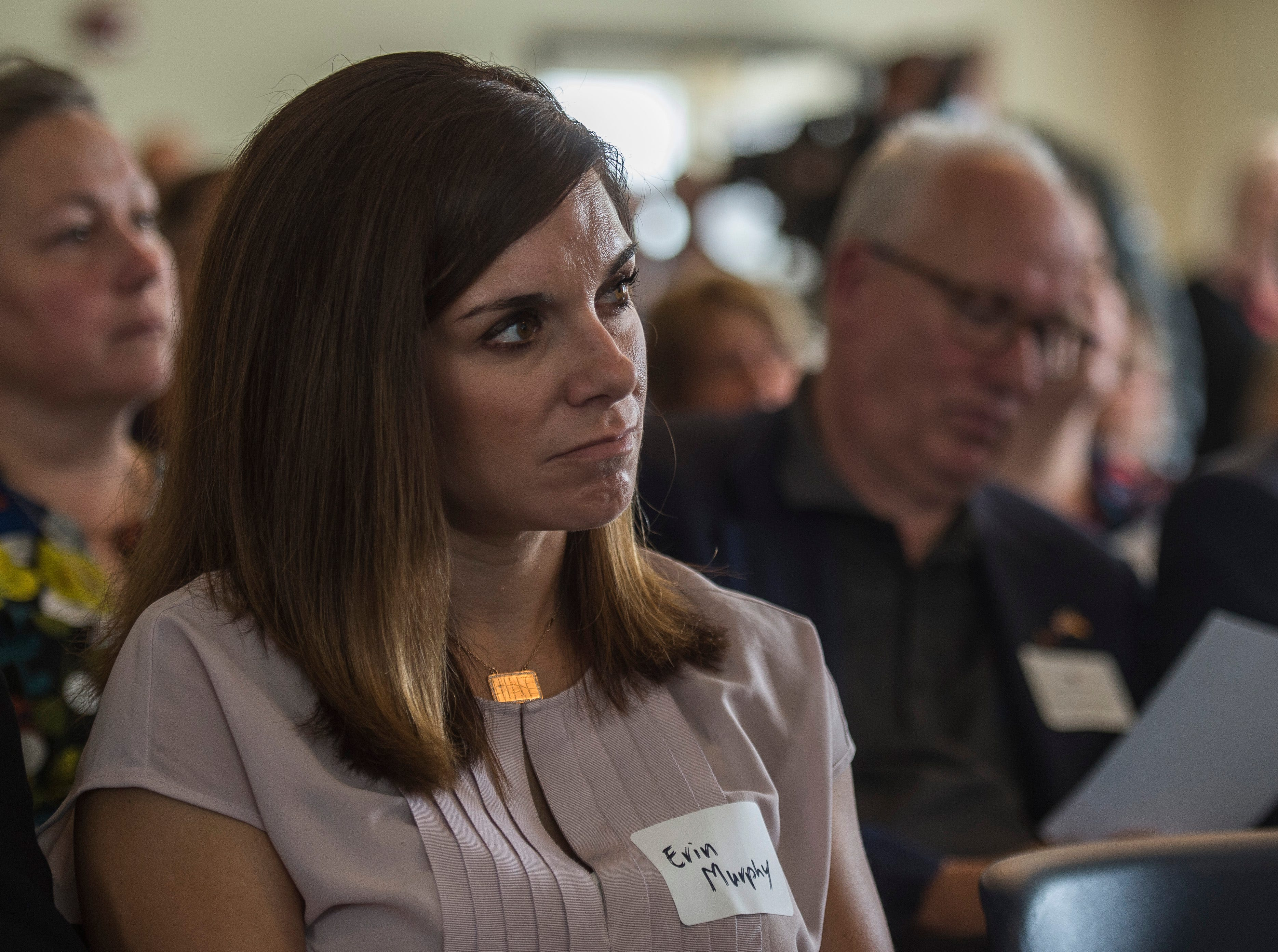 Erin Murphy listens during a news conference celebrating the opening of the Winchester House, a new drug treatment facility for women, in Winchester, Ind., on Wednesday, Aug. 1, 2018.