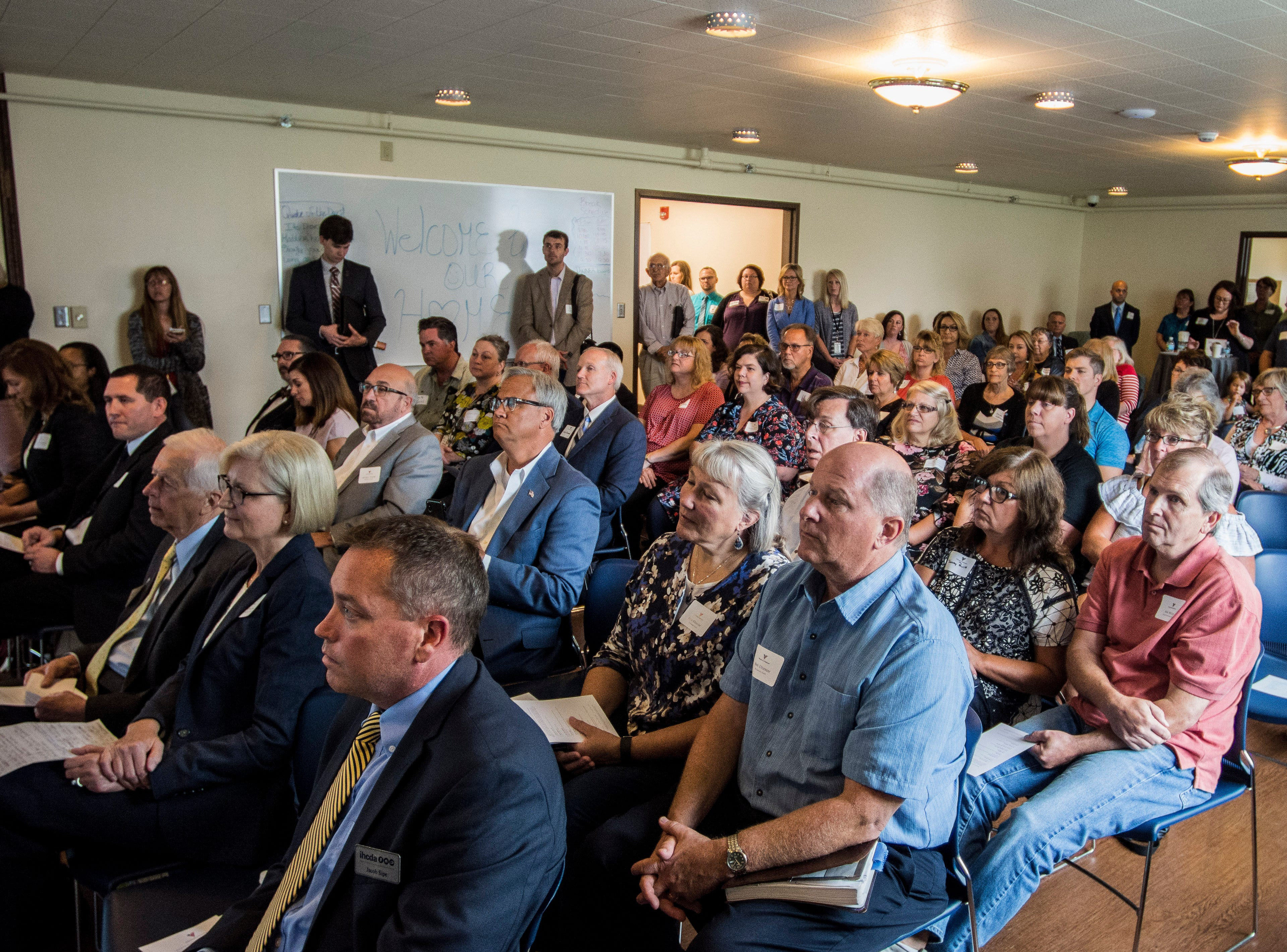 More than 75 people listen during a news conference celebrating the opening of the Winchester House, a new drug treatment facility for women, in Winchester, Ind., on Wednesday, Aug. 1, 2018.
