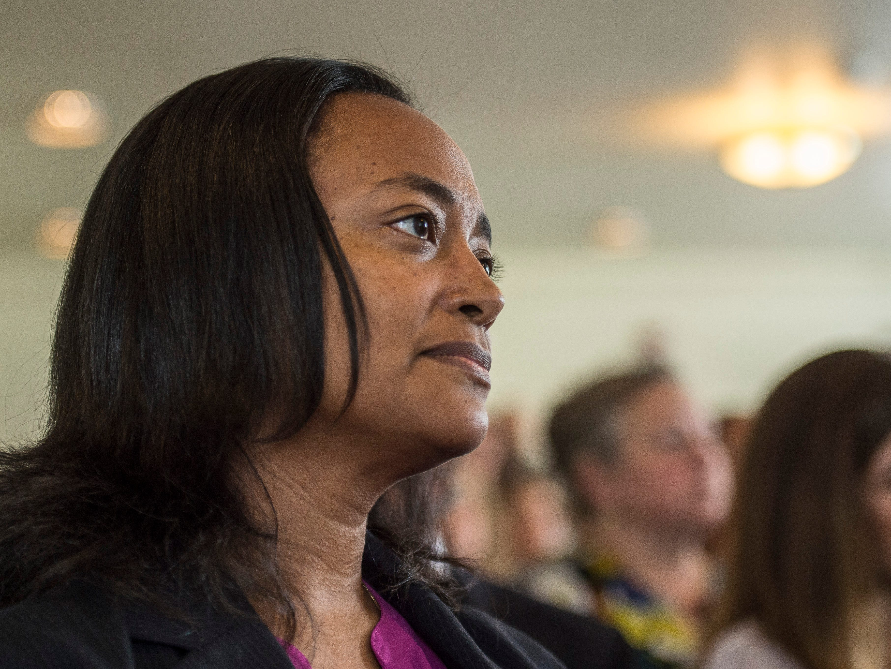 Terry Stigdon with the Indiana Dept. of Child Services listens during a news conference celebrating the opening of the Winchester House, a new drug treatment facility for women, in Winchester, Ind., on Wednesday, Aug. 1, 2018.