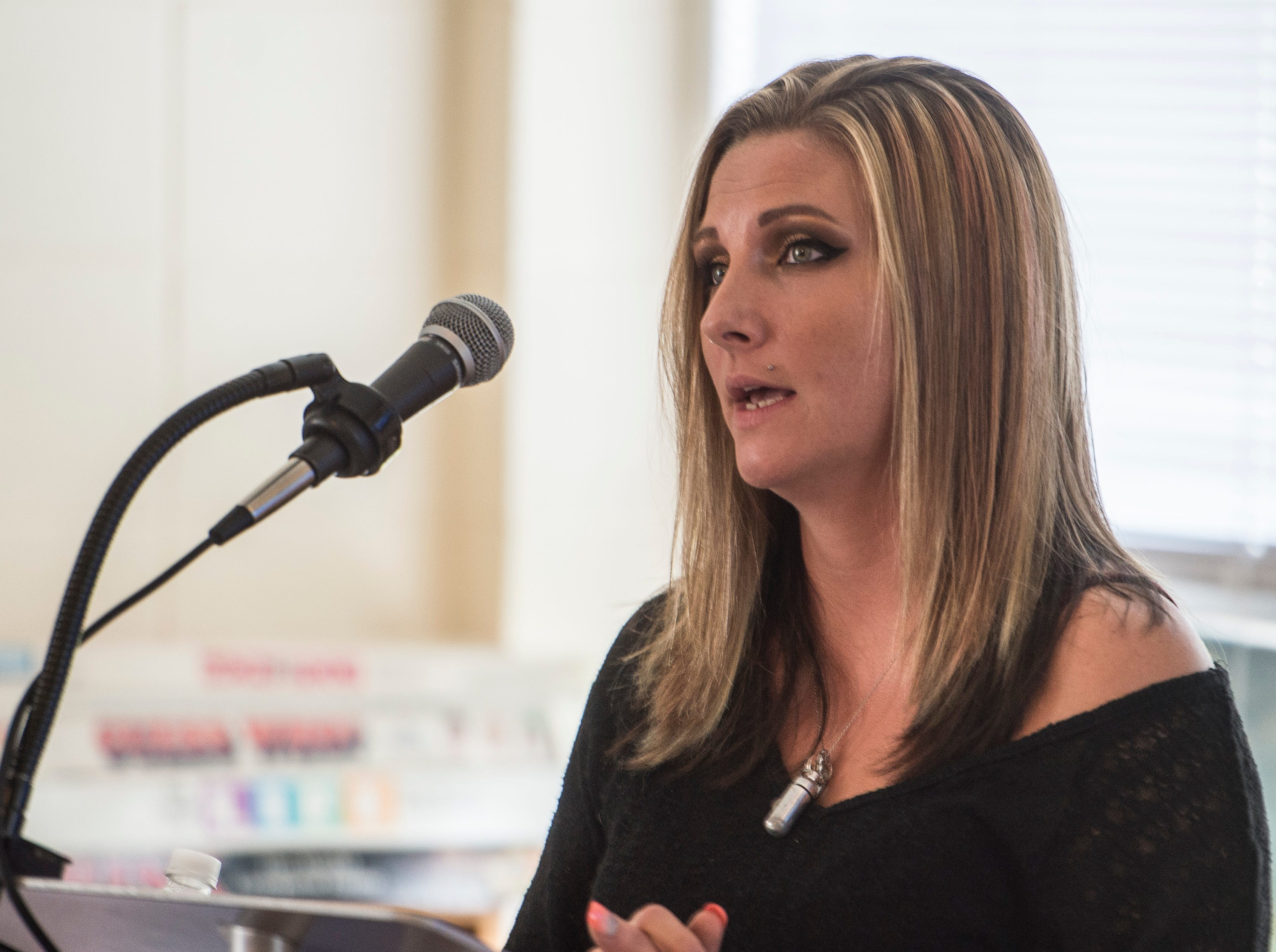 Laura Bratton, a graduate of the Fresh Start Recovery Center in Indianapolis, speaks during a news conference celebrating the opening of the Winchester House, a new drug treatment facility for women, in Winchester, Ind., on Wednesday, Aug. 1, 2018.