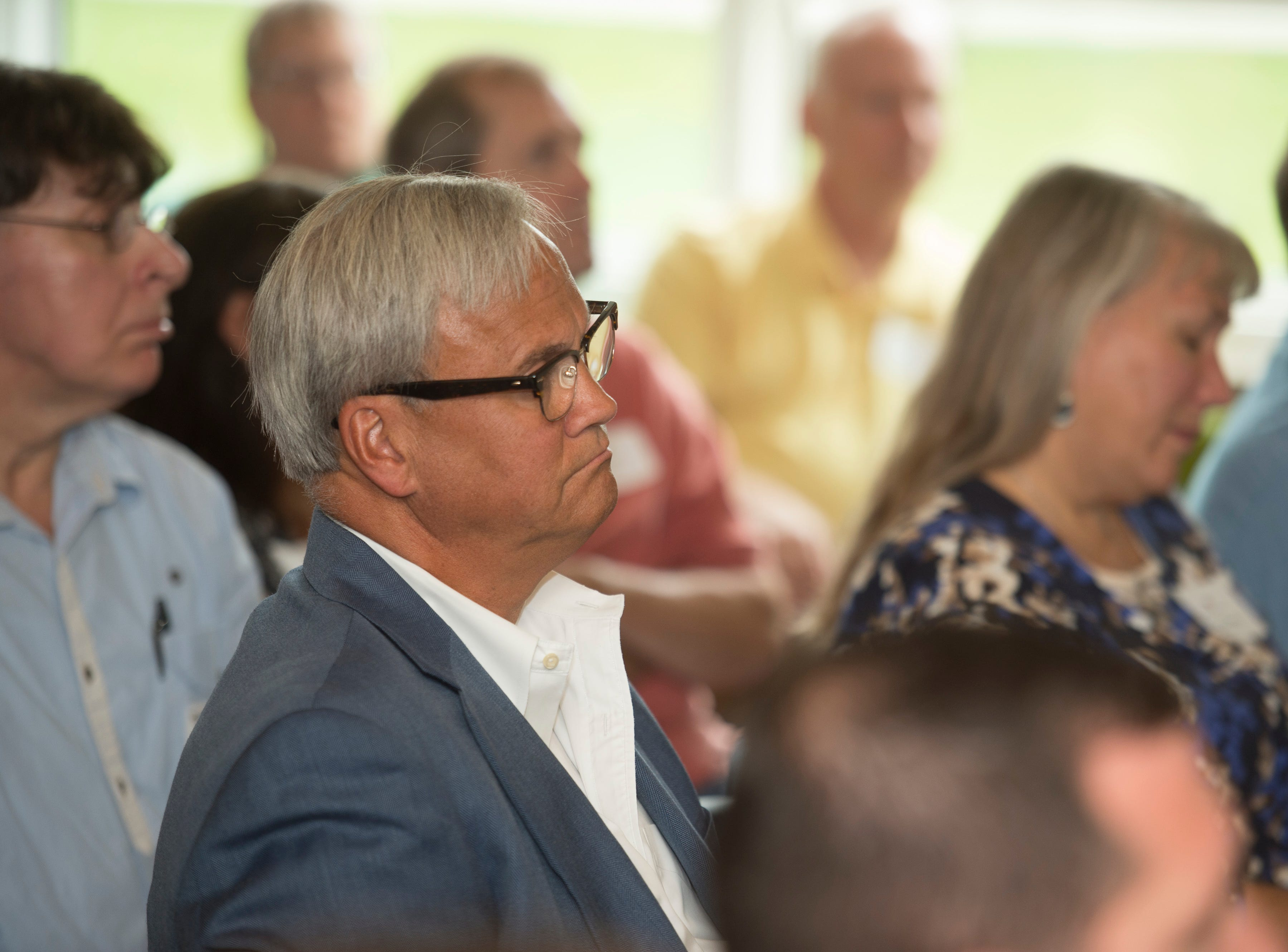 State Sen. Jim Merritt listens during news conference celebrating the opening of the Winchester House, a new drug treatment facility for women, in Winchester, Ind., on Wednesday, Aug. 1, 2018.