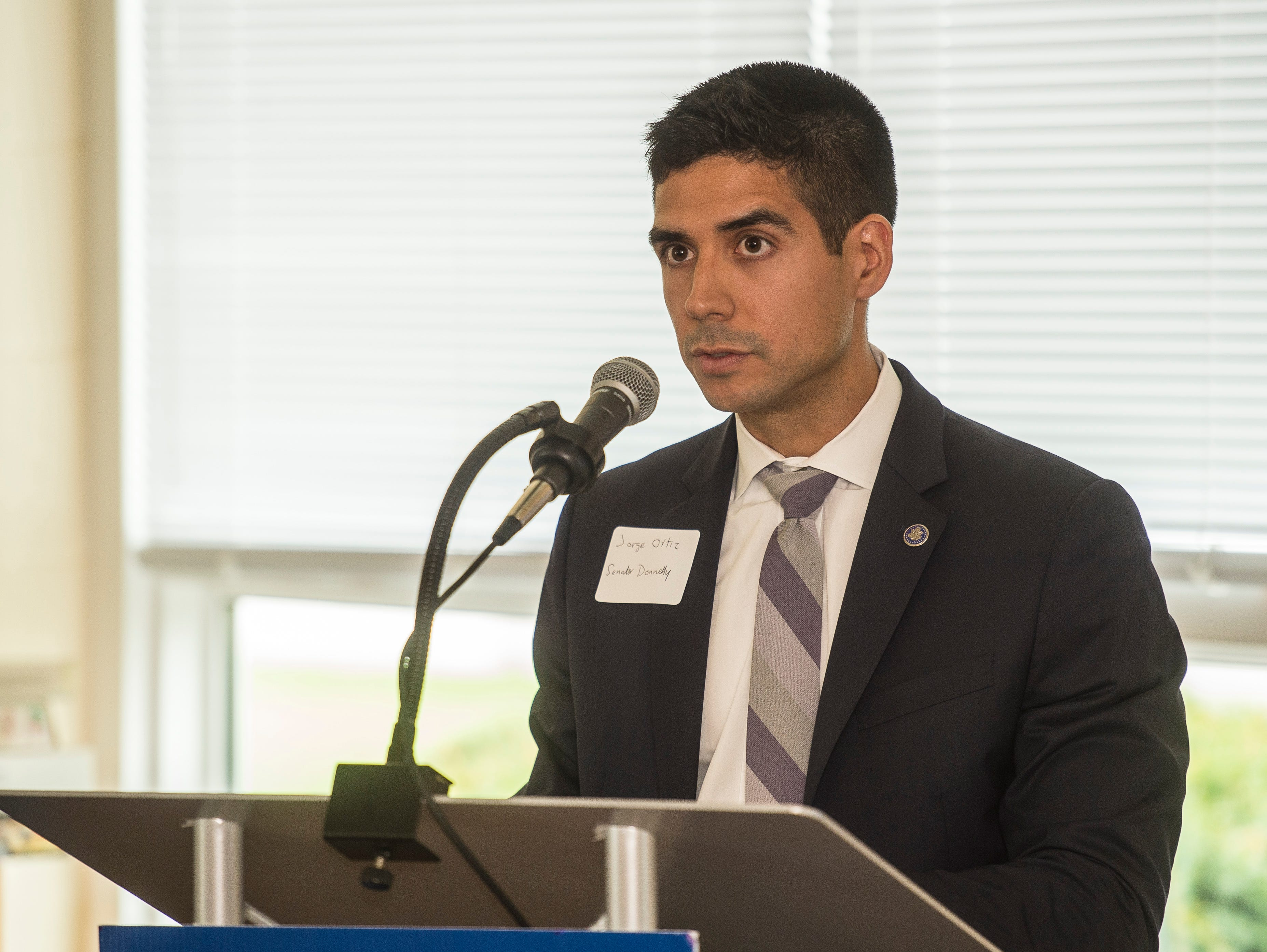 Jorge Ortiz with the office of U.S. Sen. Joe Donnelly speaks during a news conference celebrating the opening of the Winchester House, a new drug treatment facility for women, in Winchester, Ind., on Wednesday, Aug. 1, 2018.