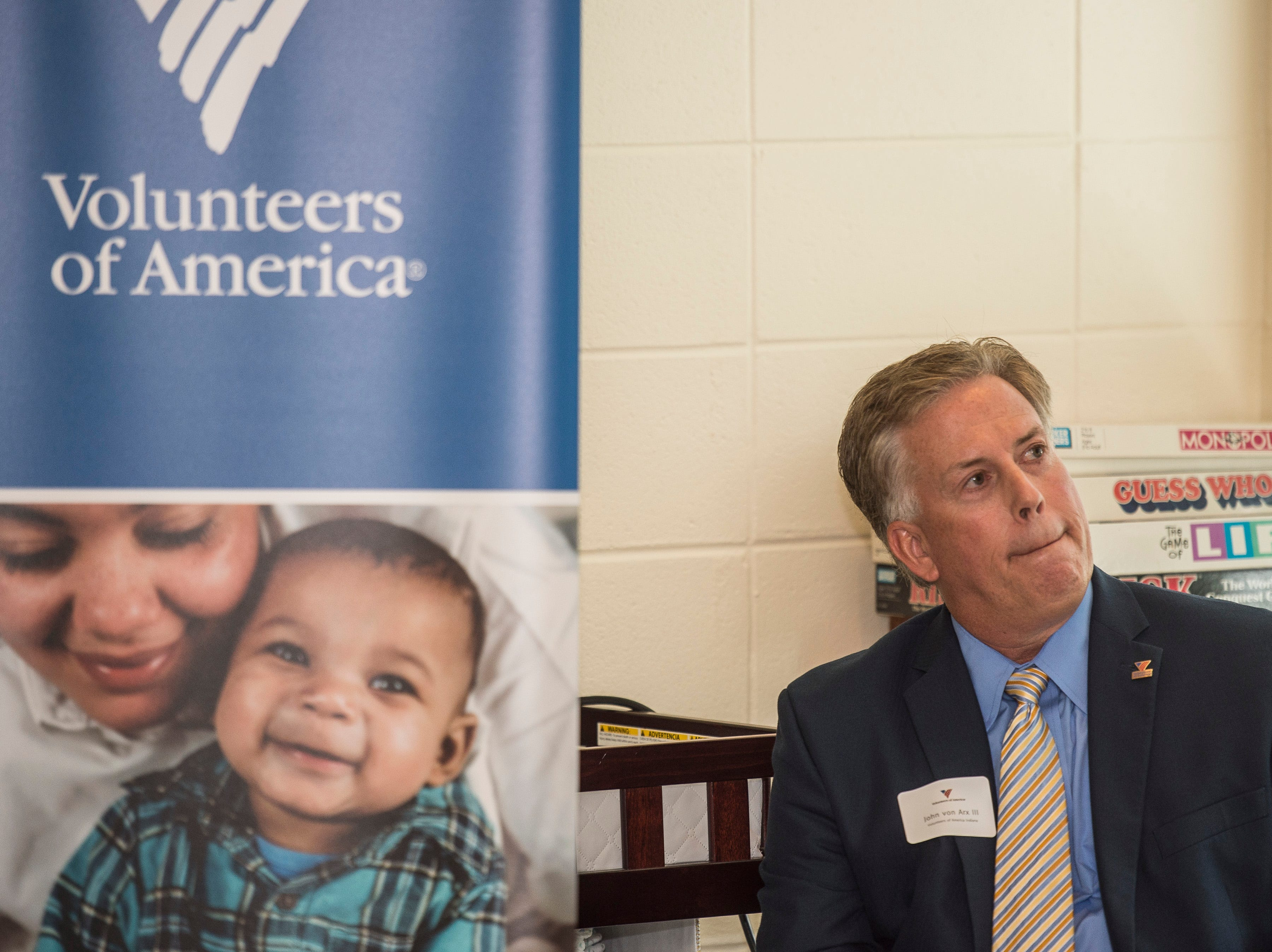 Volunteers of America Indiana president John Von Arx listens during a news conference celebrating the opening of the Winchester House, a new drug treatment facility for women, in Winchester, Ind., on Wednesday, Aug. 1, 2018.