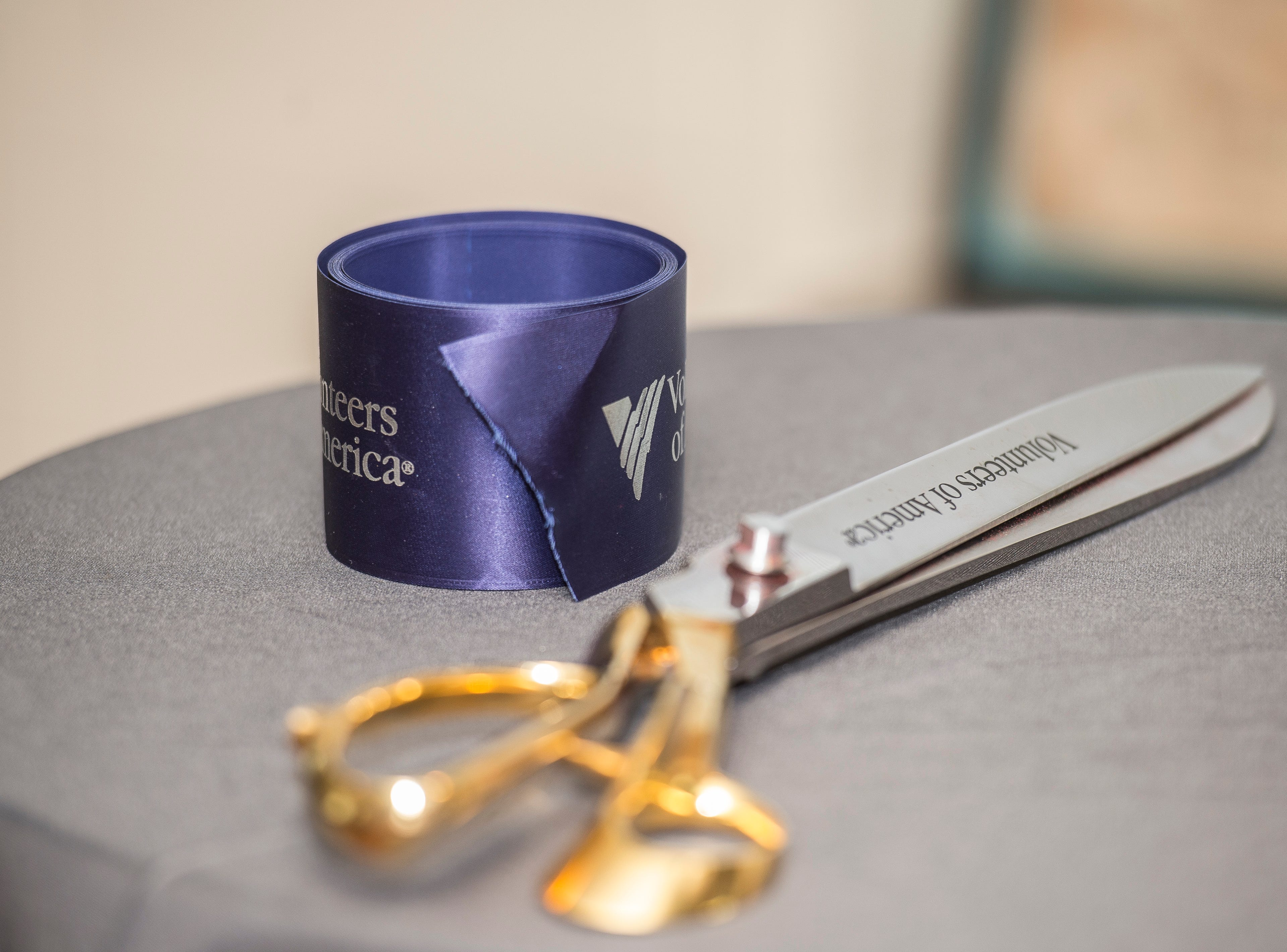 Special ribbon and scissors sit on a table for a ribbon cutting following a news conference celebrating the opening of the Winchester House, a new drug treatment facility for women, in Winchester, Ind., on Wednesday, Aug. 1, 2018.