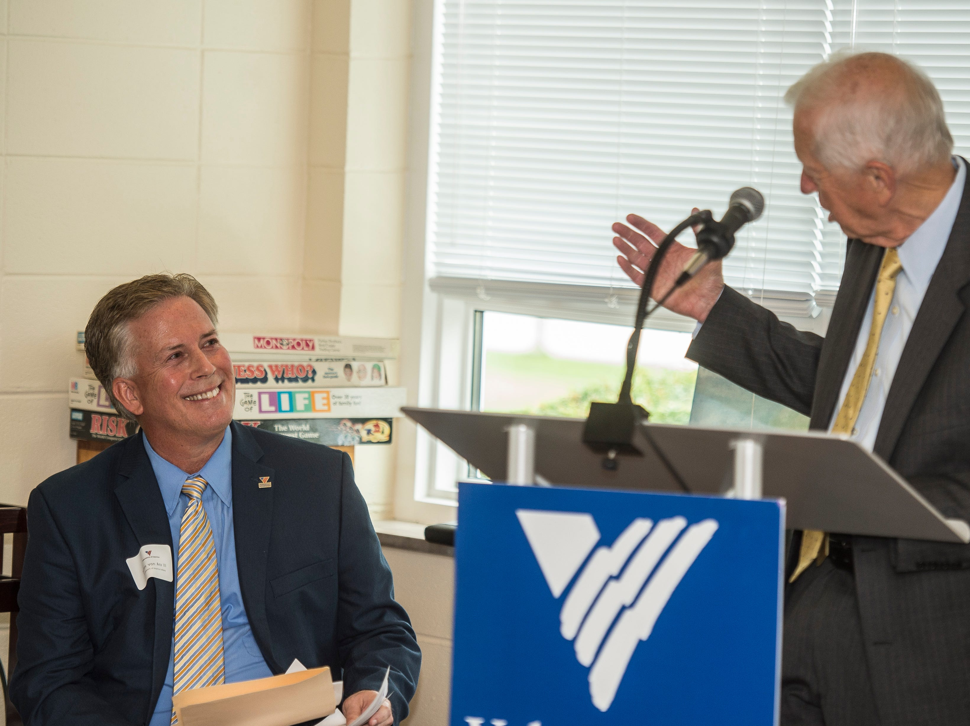 State Drug Czar Jim McClelland motions to Volunteers of America Indiana president John Von Arx during a news conference celebrating the opening of the Winchester House, a new drug treatment facility for women, in Winchester, Ind., on Wednesday, Aug. 1, 2018.