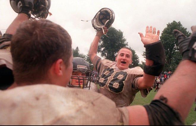 McQuaid's J.P. Novak (88) celebrates with teammates  after a 20-14 win over Aquinas on Sept. 22, 1996.