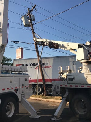 Lineman work to untangle power lines on July 31, 2018 at Wienerschnitzel.