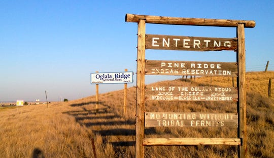 AP file photo shows the entrance to the Pine Ridge Indian Reservation in South Dakota.