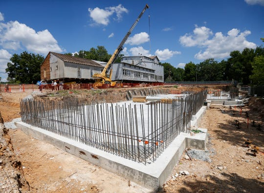 A new foundation has been poured as restoration on the Ozark Mill continues on Wednesday, Aug. 1, 2018.