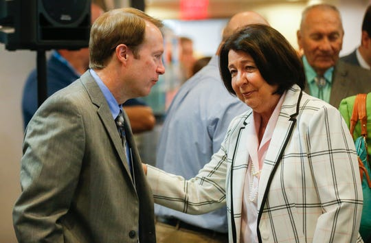 New City Manager Jason Gage talks with Councilwoman Jan Fisk before his swearing in ceremony at the Busch Municipal Building on Wednesday, Aug. 1, 2018.