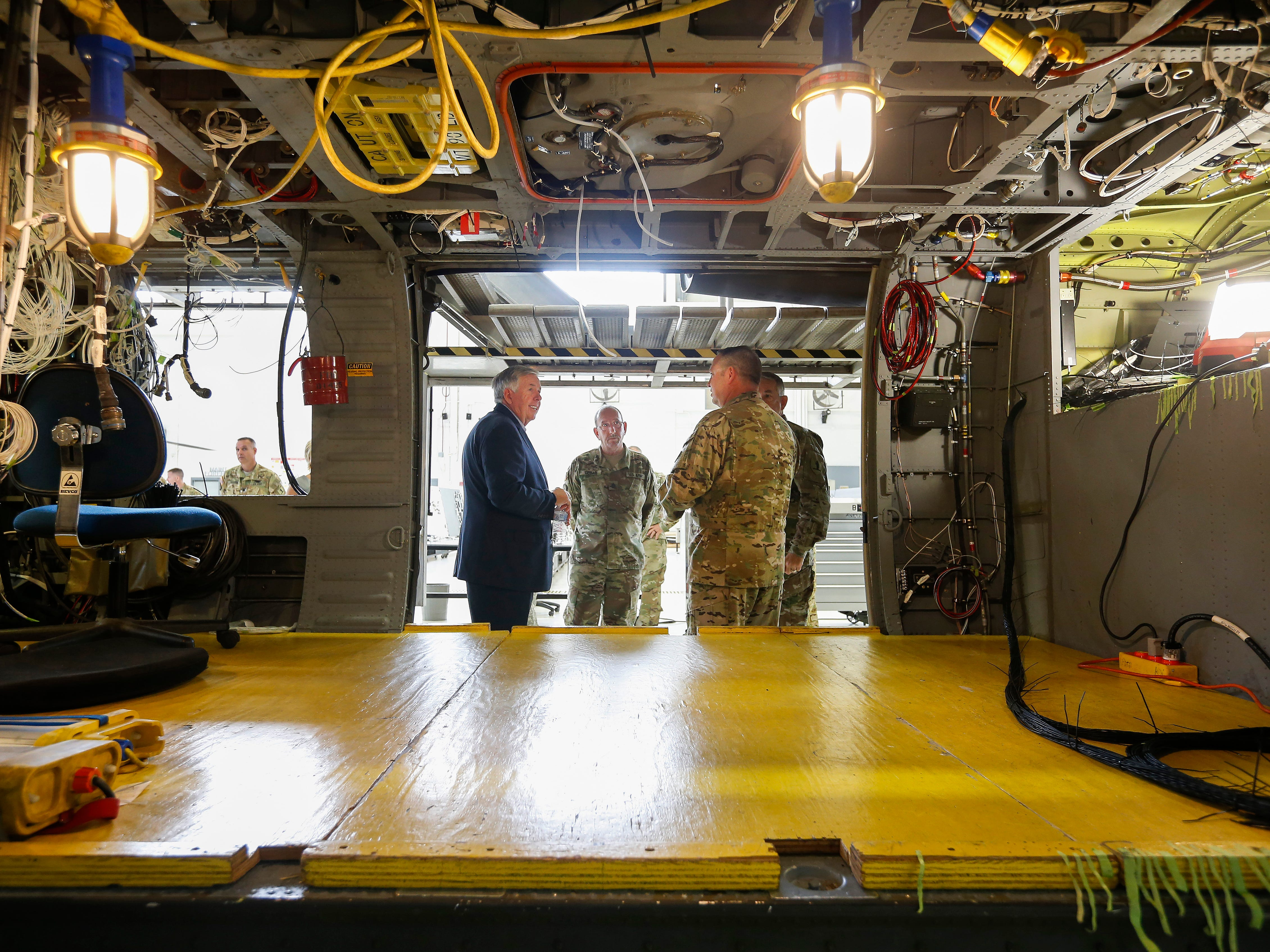 Gov. Mike Parson tours The Missouri National Guard Aviation Classification Repair Activity Depot on Wednesday, Aug. 1, 2018. Gov. Parson met with soldiers and toured the facility ahead of delivering his state of the state address in Springfield.
