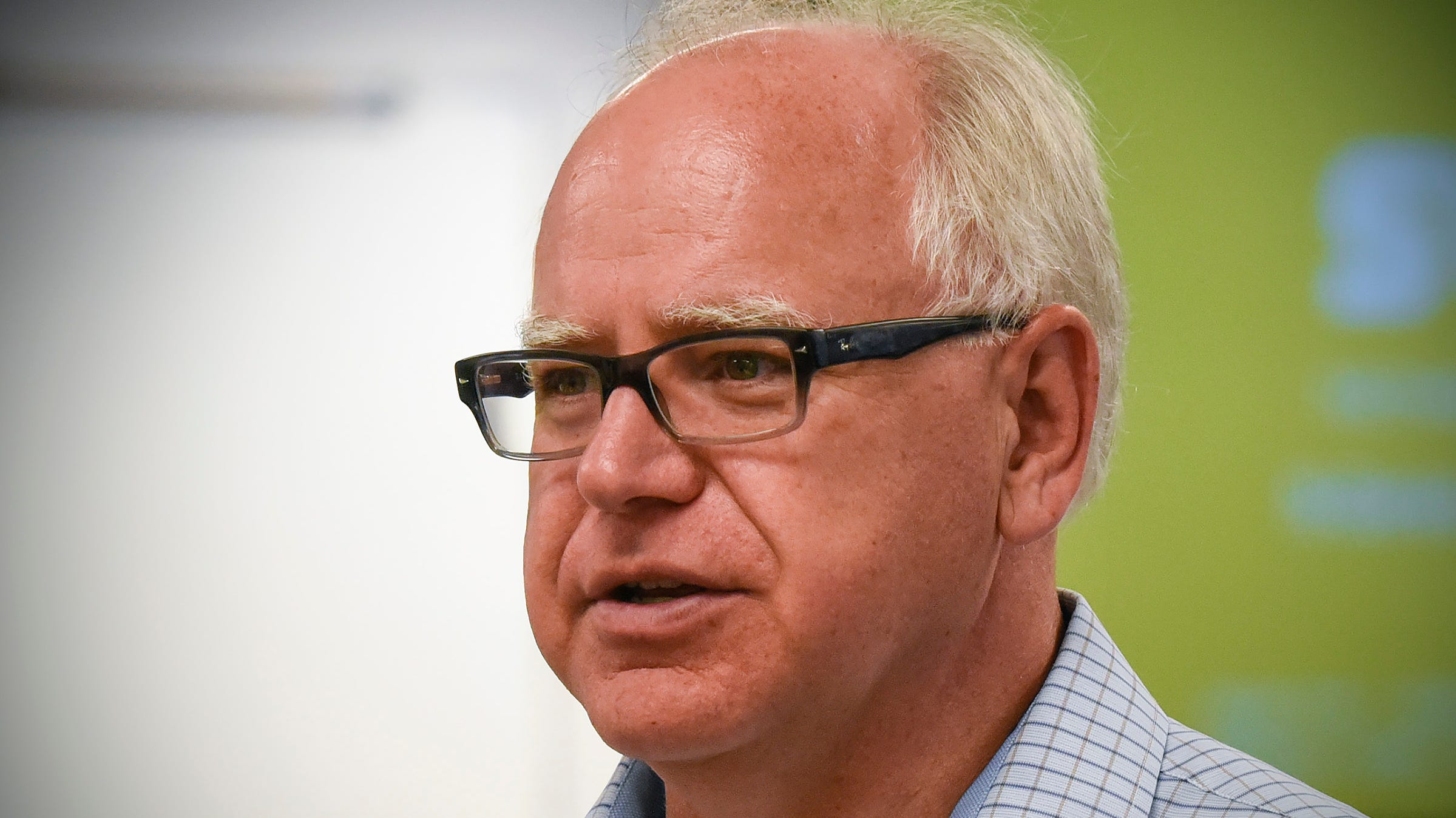 Congressman and candidate for governor Tim Walz talks with students and faculty during a tour of the Integrated Science and Engineering Laboratory Facility Wednesday, Aug. 1, at St. Cloud State University.