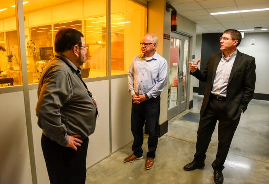 Congressman and candidate for governor Tim Walz, center, gets a tour of the Integrated Science and Engineering Laboratory Facility from Adel Ali, interim dean of the college of science and engineering, left, and Dan Gregory, interim provost and vice president for academic affairs, Wednesday, Aug. 1, at St. Cloud State University.