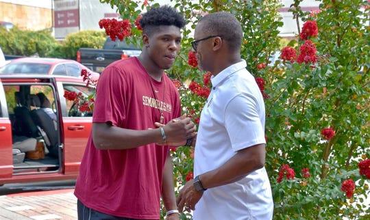 Three-star running back Tye Edwards meets with FSU head coach Willie Taggart at FSU's Saturday Night Live event.