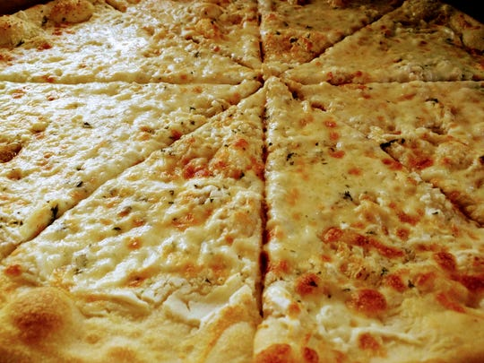 Dough Boyz classic, large white pizza with ricotta, garlic, mozzarella and Parmesan.
