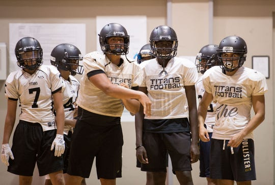 Treasure Coast High School trains indoors Wednesday, Aug. 1, 2018, during the first week of football practice at the school in Port St. Lucie.