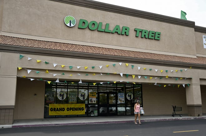 A customer leaves the newly opened Dollar Tree at Tulare's Monte Vista Shopping Center on Monday, July 30, 2018.