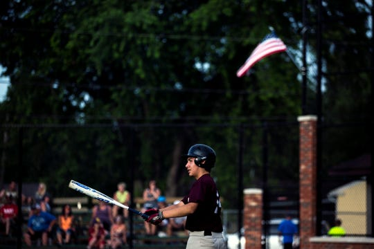 Marco Olvera, 15, Jose Olvera's oldest son, practices his swing while at bat during a baseball game in Abbotsford, Wis., July 11, 2018.