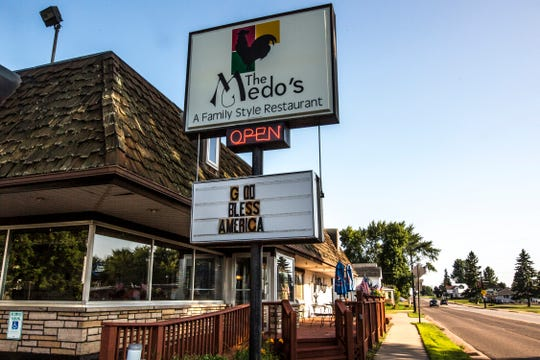 Medo's Family Style Restaurant in Abbotsford, Wis., dispays a patriotic message, July 29, 2018.