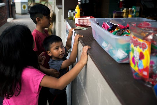 Kids buy concessions during a baseball game in Abbotsford, Wis., July 11, 2018. About a quarter of Abbotsford's population of 2,100 is Hispanic.