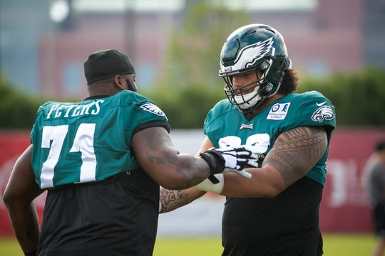 Eagles tackle Jason Peters (left) chats with rookie Jordan Mailata, right, at a recent practice.