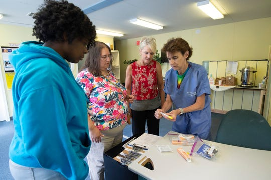 Dr. Sandy Gibney, right, goes over the instructions for administering Naloxone Hydrochloride at Dover Interfaith Mission for Housing in Dover.