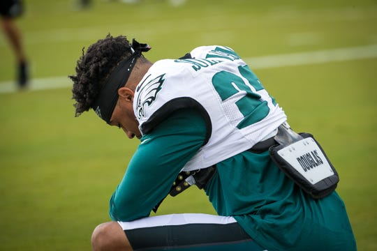Eagles safety Tre Sullivan takes a moment for prayer at a recent training camp practice at the NovaCare Complex in Philadelphia.