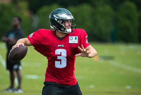 Eagles quarterback Joe Callahan runs practice drills at training camp Wednesday at the NovaCare Complex in Philadelphia.