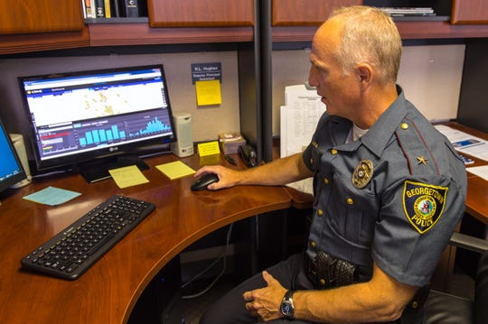 Georgetown Police Chief R.L. Hughes demonstrates the Crime View program giving real time data used to fight crimes in Georgetown soon after he became chief in 2015.