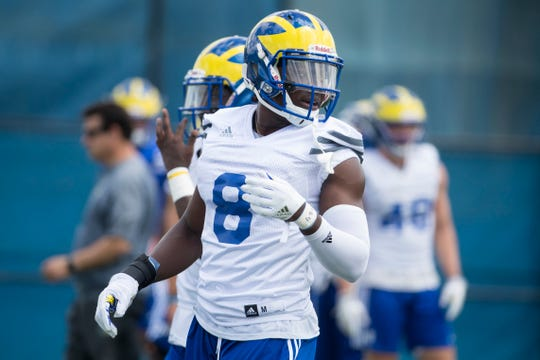 Tenny Adewusi listens to instructions during Delaware football practice.