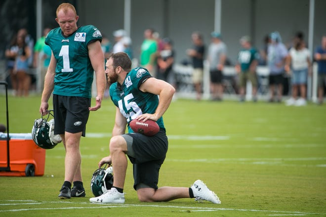 Eagles punter Cameron Johnston (left) and long snapper Rick Lovato at training camp Wednesday.