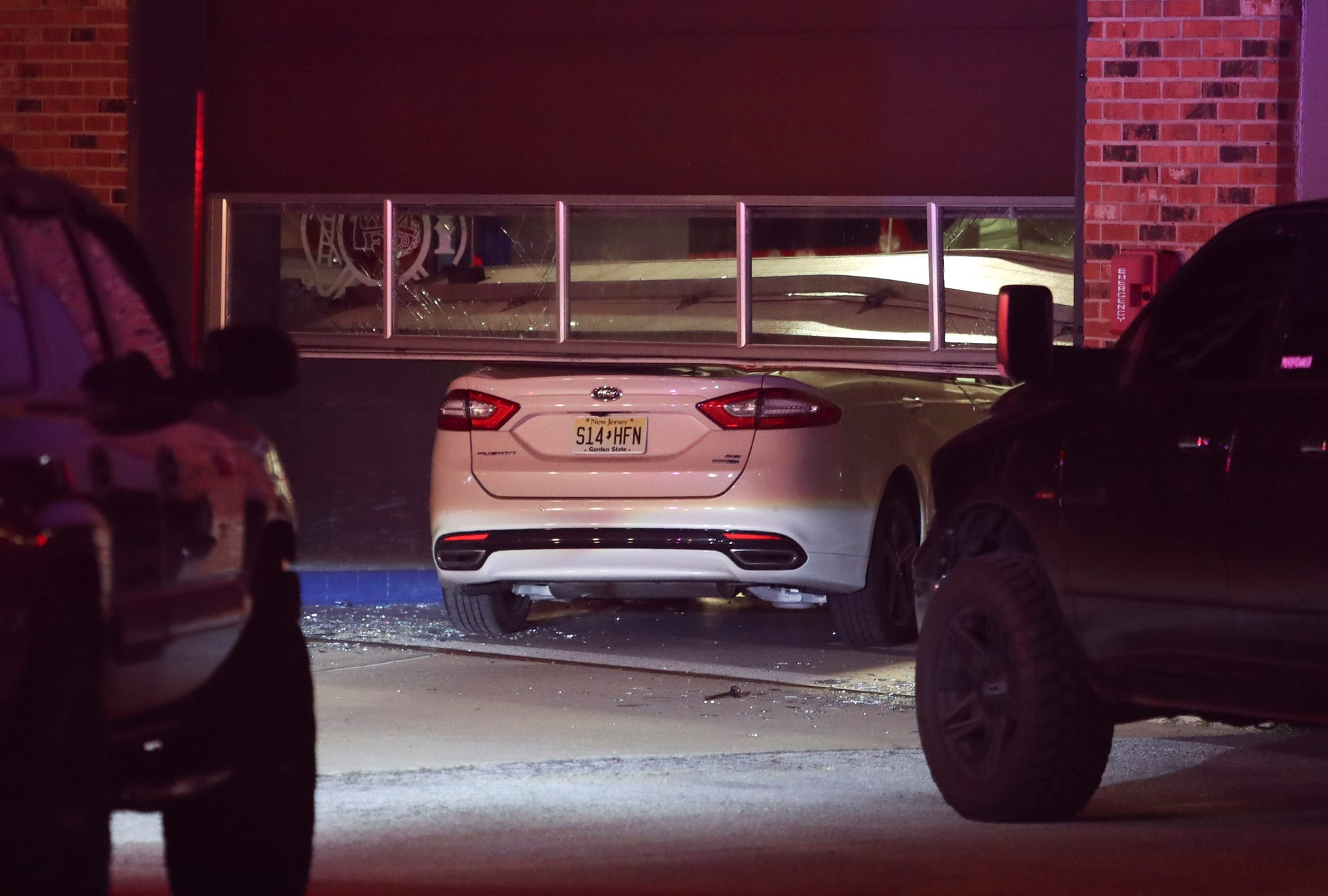 Car Plunges Into Fire Station In Dupont Highway Wreck