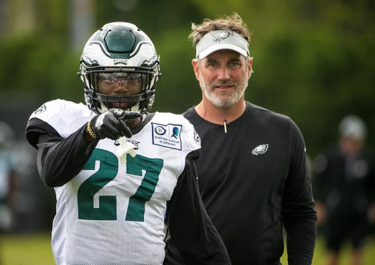 Eagles safety Malcolm Jenkins acknowledges a fan during his warmup drills at training camp Wednesday at the NovaCare Complex in Philadelphia.